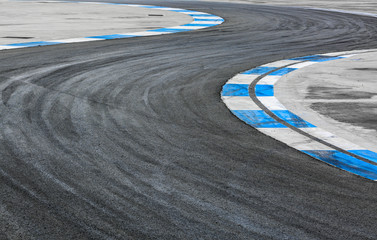 Door stickers F1 Motor racing track. Turning asphalt road with marking lines at International race track.