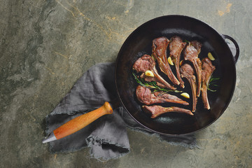 Lamb chops sauteed in a cast iron pan