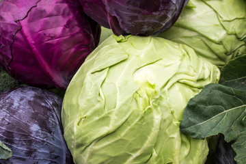 Red and white cabbage on the counter of the market