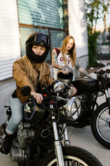 Attractive girls riding vintage motorcycles