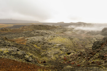 Wilderness landscape in Iceland with volcanic steams coming out of the ground