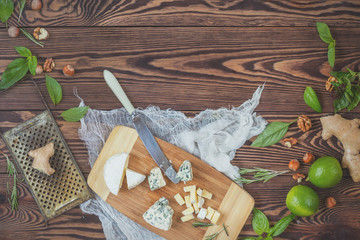Top view of organic natural fresh healthy food and kitchen items on wooden background with copy space