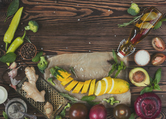 Top view of organic natural fresh vegetables on wooden background with copy space