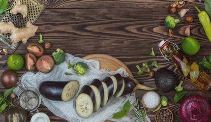 Top view of variety of organic natural fresh vegetables on wooden background with copy space