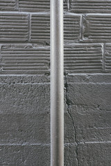 Metal pipe and building wall exterior