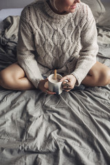 Woman Drinking Hot Coffee in Bed in the Morning
