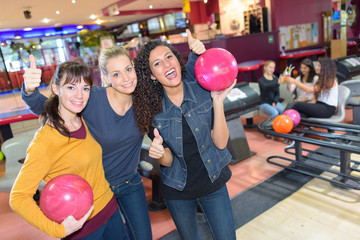 Portrait of three women at bowling alley