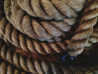 Pile of old thick nautical sailing rope cord