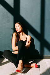 Fashion shot of the woman in contrast light