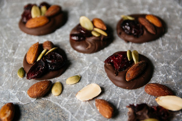 Chocolate topped with pumpkin seeds, cranberry and almonds