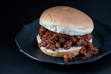 sloppy joe on bun with dark background