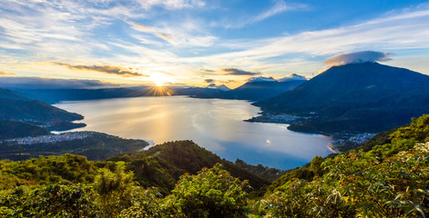 Sunrise in the morning at lake Atitlan, Guatemala - amazing panorama view to the volcanos San Pedro, Toliman and Atitlan