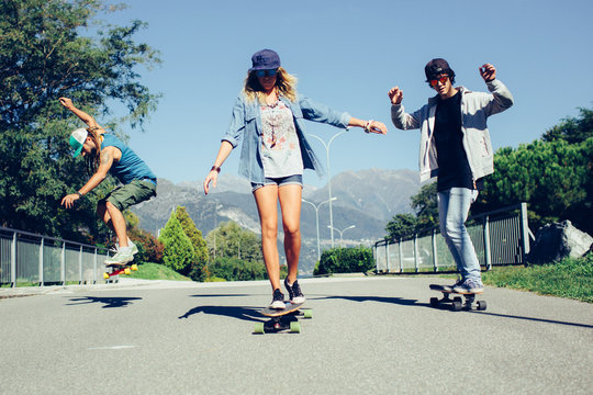 Group of friends skateboarding outdoors