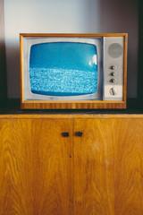 Old analog TV displaying noise