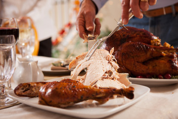 Thanksgiving: Father Slices White Meat From Roasted Turkey