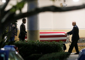 Following a public viewing, the coffin of U.S. Army Sergeant La David Johnson, who was among four special forces soldiers killed in Niger, is taken from Christ The Rock Church in Cooper City,
