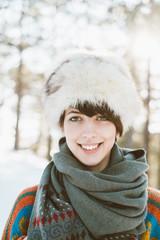 Portrait of a beautiful smiling woman wearing winter hat