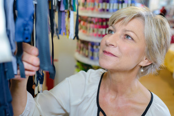 Mature woman looking at zips