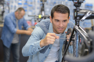 man assembling the bike carefully