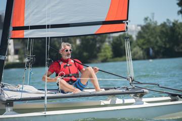 Spoed Foto op Canvas Zeilen sailing man on boat