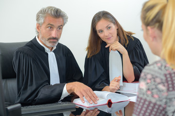 Client with legal professionals