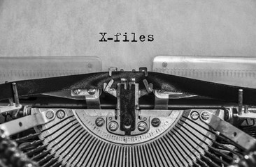 X-files, classified materials are printed on an old vintage typewriter. Close-up.