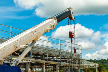 Truck and Crane in site for construction and blue sky