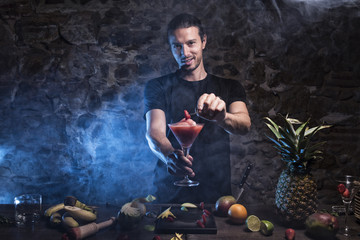 Man working at cocktail bar