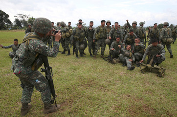 A member of the Philippine Marine Battalion Landing Team (MBLT) used a mobile phone to take souvenir pictures of his comrades during their send-off ceremony inside a military headquarters in Marawi city