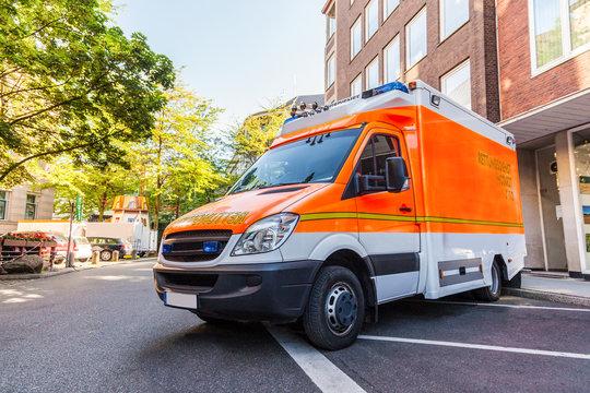 german ambulance car stands on parking lot