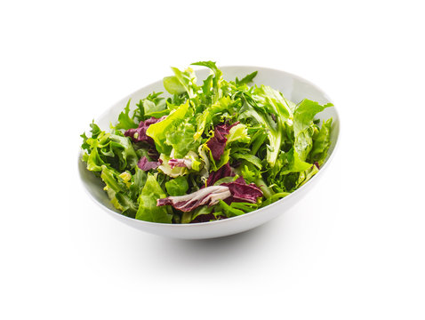 Salad Isolated on White. A bowl of fresh lettuce green salad over white with shadow