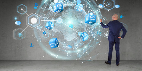 Businessman using digital planet earth interface on a wall 3D rendering