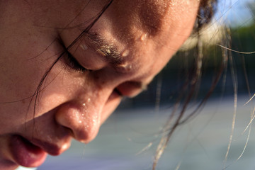 Closeup  sweating on face asian women . Exercise on park