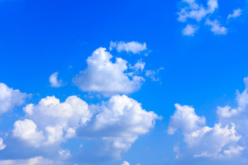 Blue sky with white clouds. rain clouds on sunny summer or spring day.