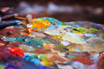 The palette of oil paints close up