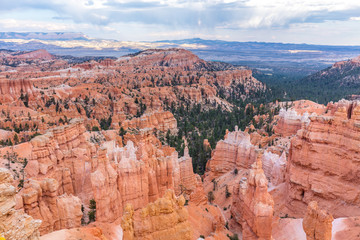 Spectacular view at the cliffs and cloud sky. Amazing mountain landscape. Breathtaking view of the canyon. Bryce Canyon National Park. Utah. USA