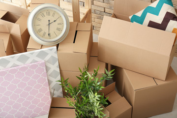 Move house concept. Carton boxes and belongings on floor in room