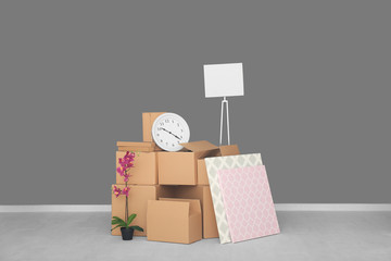 Move house concept. Carton boxes and belongings on floor in empty room