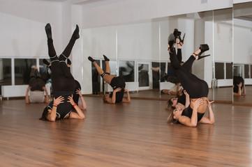 Attractive girls dancing strip-plastic in the dance class