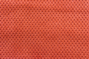 Texture of natural linen fabric in pattern orange color close-up in vintage style