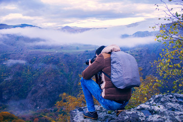 a man takes pictures of mountains