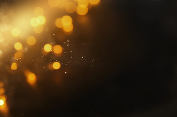 abstract bokeh background of golden light burst.
