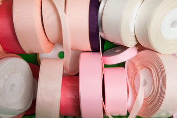 Sewing notions, colorful ribbons assortment, close up. Tailor workshop background, decoration concept
