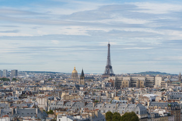 skyline of Paris city with eiffel tower from above in soft morning light, France