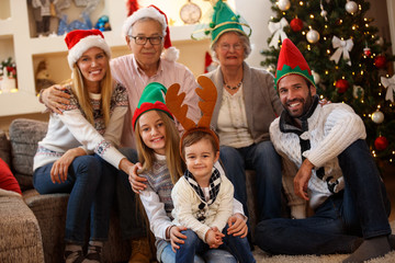 Parents with grandparents and children together for Christmas