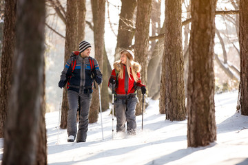 Female and male hiker walking in forest