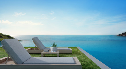 Sea view swimming pool beside terrace and beds in modern luxury beach house with blue sky background, Lounge chairs on green grass at vacation home or hotel - 3d illustration of tourist resort