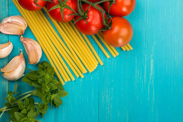 Italian Cooking Ingredients Including Pasta Spaghetti Garlic and Vine Tomatoes