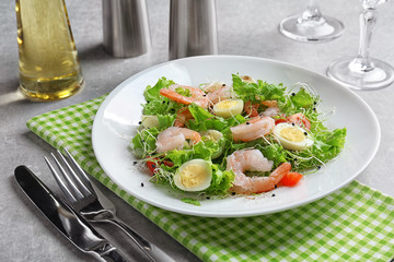 Plate with fresh tasty shrimp salad on table