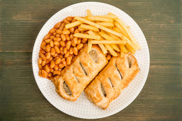 Sausage Rolls With Baked Beans Chips And French Fries